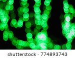 green bokeh abstract lights on... | Shutterstock . vector #774893743