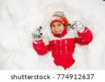 boys playing in really big snow | Shutterstock . vector #774912637