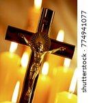 Crucifix And Church Candles   ...