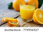 freshly squeezed orange juice | Shutterstock . vector #774956527
