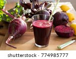 red beet juice in a glass on a...