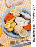 Small photo of Typical portuguese meal with hake fish with cauliflower, carrots and potatoes.