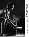 vertical shot a female crossfit ... | Shutterstock . vector #775002943