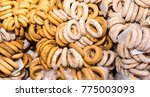 a lot of bagels with poppy... | Shutterstock . vector #775003093
