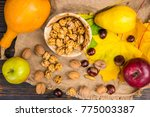top view of wooden plate with... | Shutterstock . vector #775003387