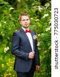 groom at wedding tuxedo smiling ... | Shutterstock . vector #775030723