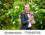 groom at wedding tuxedo smiling ... | Shutterstock . vector #775030753