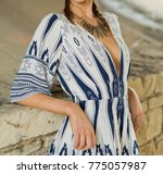 model in a print romper and...   Shutterstock . vector #775057987