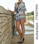 model in a print romper   Shutterstock . vector #775057993