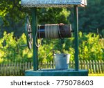 the well and the bucket are on... | Shutterstock . vector #775078603
