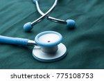stethoscope in doctor's coat   Shutterstock . vector #775108753