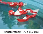 red and white paper ship in... | Shutterstock . vector #775119103