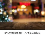 empty wood table top and blur... | Shutterstock . vector #775123033