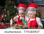 twin girls in red making... | Shutterstock . vector #775183927