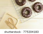 chocolate donuts and wooden... | Shutterstock . vector #775204183
