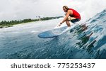 young surfer rides the ocean... | Shutterstock . vector #775253437