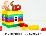 colorful toy house and toy... | Shutterstock . vector #775285267