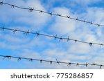 barbed wire under tension under ... | Shutterstock . vector #775286857