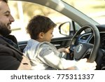 father playing teaching baby to ... | Shutterstock . vector #775311337