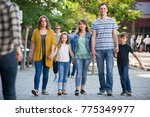 happy family on a walk in the... | Shutterstock . vector #775349977