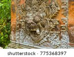 Small photo of The Raksasa Wall is built just inside the temple entrance. It has a carved image of a demon god in the center and is used to 'deter' demons from entering the temple. Ubud, Bali - August 2015