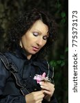 Small photo of Frau mit Blumen oder Blüten, Woman with flowers or flowers