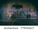 people holding smoke bombs and... | Shutterstock . vector #775454617