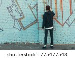 back view of man painting... | Shutterstock . vector #775477543