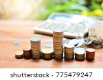 money saving pile up and down...   Shutterstock . vector #775479247
