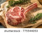 raw red grass fed tomahawk... | Shutterstock . vector #775544053