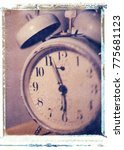 Small photo of old style vintage antique windup alarm clock with bells, numbers and hands to keep time
