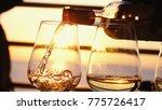 Pouring White Wine In Glasses...