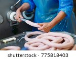 butchers processing sausages at ... | Shutterstock . vector #775818403