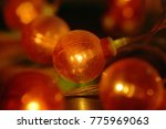 electric garland with red bulbs ...   Shutterstock . vector #775969063
