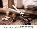 sewing tools on wooden table | Shutterstock . vector #775989097