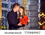 a guy gives a gift to a girl at ... | Shutterstock . vector #775989907