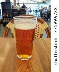Small photo of GOTEBURG, SWEDEN - CIRCA AUGUST 2017: a pint of British ale beer John Scott's