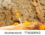 metal hunting knife on a log... | Shutterstock . vector #776068963