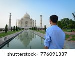 a young tourist looking at taj... | Shutterstock . vector #776091337