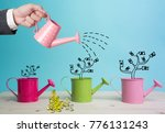 Small photo of Top view Investment is like planting trees. Take care it will provide a good growth on colour background.Watering can and money tree drawn concept for business investment, savings and making money.