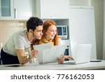 happy couple at home paying... | Shutterstock . vector #776162053