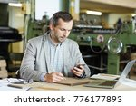 busy engineer with smartphone...   Shutterstock . vector #776177893