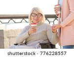 disabled senior woman and young ... | Shutterstock . vector #776228557