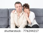 Small photo of couple sulk on the sofa in living room at home