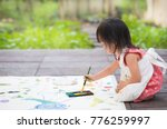adorable asian little girl is... | Shutterstock . vector #776259997