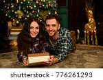 couple with christmas present | Shutterstock . vector #776261293