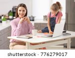 busy young woman with daughter... | Shutterstock . vector #776279017
