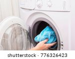 woman loading laundry to the... | Shutterstock . vector #776326423