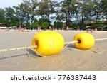 Yellow Floating Buoys For The...