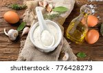 Small photo of Homemade Garlic mayonnaise sauce on rustic wooden background. Aioli dip.